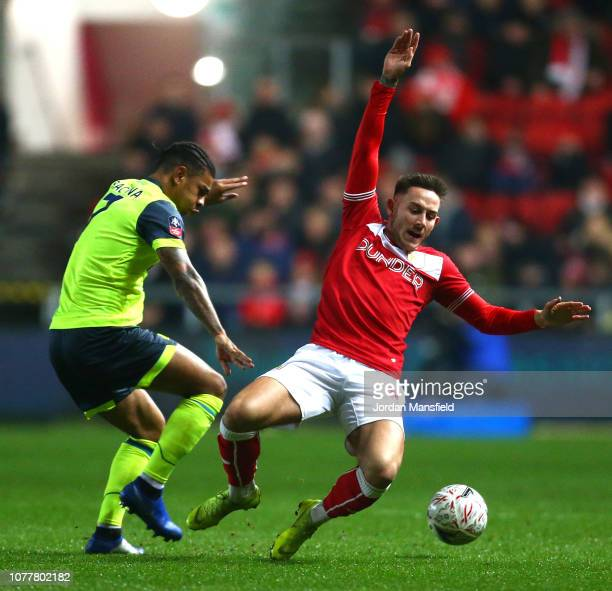 Josh Brownhill of Bristol City challenges Juninho Bacuna of Huddersfield Town during the FA Cup Third Round match between Bristol City and...