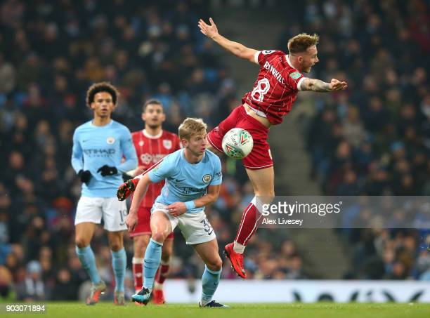 Josh Brownhill of Bristol City is challenged by Alexander Zinchenko of Manchester City during the Carabao Cup SemiFinal First Leg match between...
