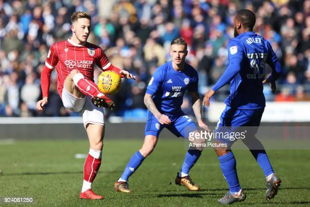 Josh Brownhill of Bristol City is marked by Joe Bennett and Junior Hoilett of Cardiff City during the Sky Bet Championship match between Cardiff City...