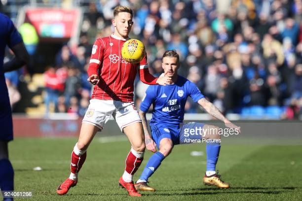 Josh Brownhill of Bristol City is marked by Joe Bennett of Cardiff City during the Sky Bet Championship match between Cardiff City and Bristol City...