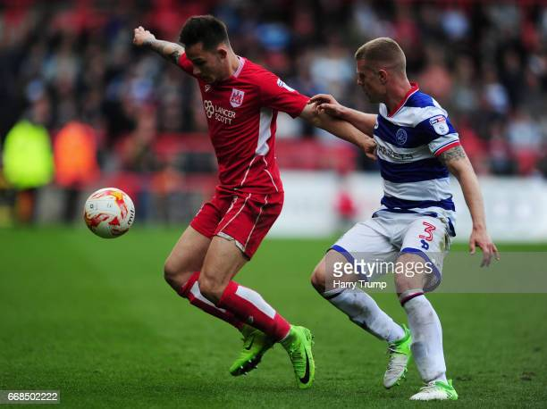 Josh Brownhill of Bristol City is tackled by Jake Bidwell of Queens Park Rangers during the Sky Bet Championship match between Bristol City and...