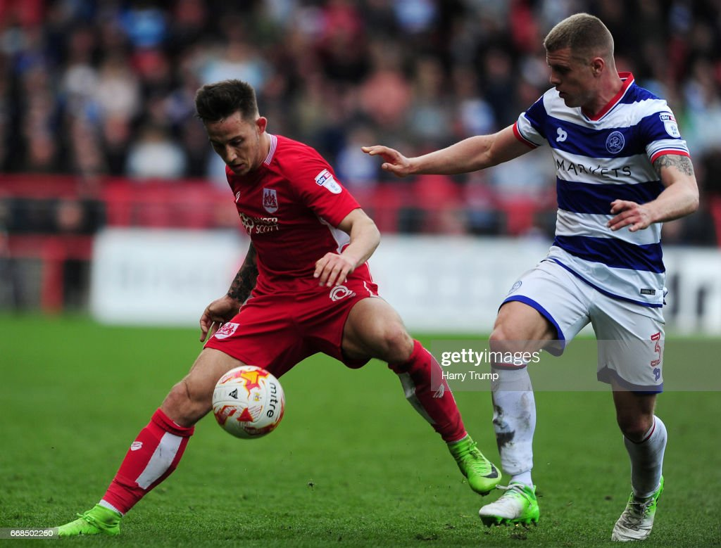Josh Brownhill of Bristol City is tackled by Jake Bidwell of Queens Park Rangers during the Sky Bet Championship match between Bristol City and Queens Park Rangers at Ashton Gate on April 14, 2017 in Bristol, England.