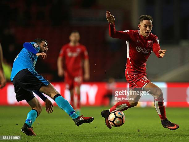 Josh Brownhill of Bristol evades the challenge of Conor McLaughlin of Fleetwood during The Emirates FA Cup Third Round match between Bristol City and...