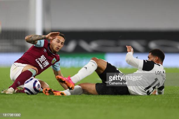 Josh Brownhill of Burnley battles for possession with Ruben Loftus-Cheek of Fulham during the Premier League match between Fulham and Burnley at...