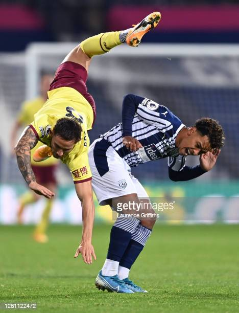 Josh Brownhill of Burnley falls over Matheus Pereira of West Bromwich Albion during the Premier League match between West Bromwich Albion and Burnley...