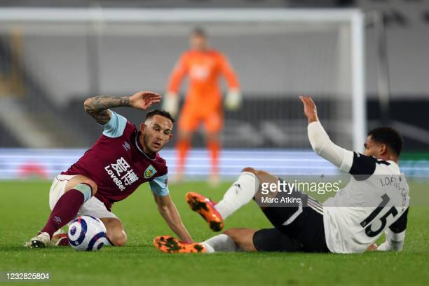 Josh Brownhill of Burnley in action with Ruben Loftus-Cheek of Fulham during the Premier League match between Fulham and Burnley at Craven Cottage on...