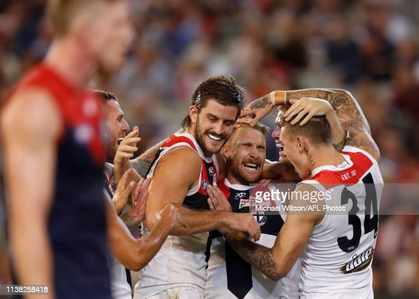 Josh Bruce Dean Kent and Matthew Parker of the Saints celebrate during the 2019 AFL round 05 match between the Melbourne Demons and the St Kilda...