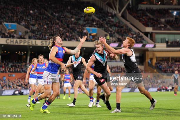 Josh Bruce of the Bulldogs and Willem Drew of the Power compete for the ball during the round 9 AFL match between the Port Adelaide Power and the...
