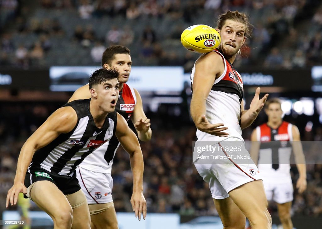 Josh Bruce of the Saints attempts to juggle a mark ahead of Brayden Maynard of the Magpies during the 2017 AFL round 04 match between the Collingwood Magpies and the St Kilda Saints at Etihad Stadium on April 16, 2017 in Melbourne, Australia.