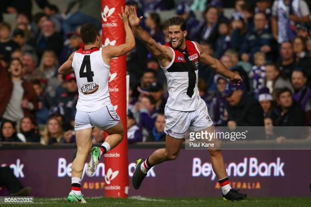 Josh Bruce of the Saints celebrates with Jade Gresham after kicking the winning goal during the round 15 AFL match between the Fremantle Dockers and...