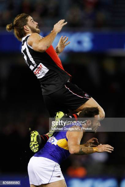 Josh Bruce of the Saints leaps for a high mark attempt over Chris Masten of the Eagles during the round 20 AFL match between the St Kilda Saints and...