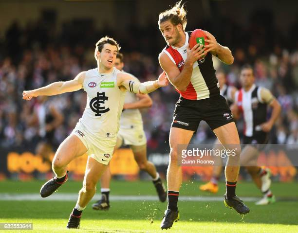 Josh Bruce of the Saints marks infront of Lachie Plowman of the Blues during the round eight AFL match between the St Kilda Saints and the Carlton...
