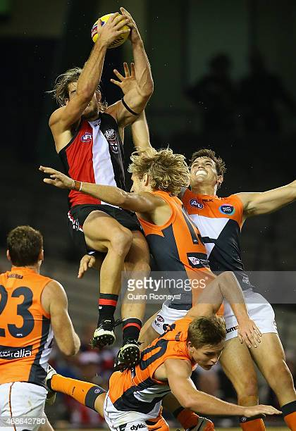 Josh Bruce of the Saints marks over the top of Adam Tomlinson of the Giants during the round one AFL match between the St Kilda Saints and the...