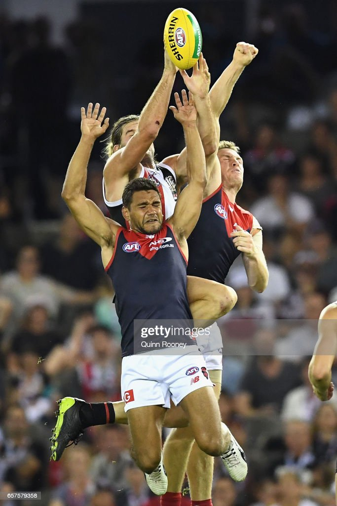Josh Bruce of the Saints marks over the top of Neville Jetta of the Demons during the round one AFL match between the St Kilda Saints and the Melbourne Demons at Etihad Stadium on March 25, 2017 in Melbourne, Australia.