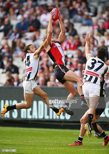 Josh Bruce of the Saints marks the ball against James Aish of the Magpies during the round three AFL match between the St Kilda Saints and the...