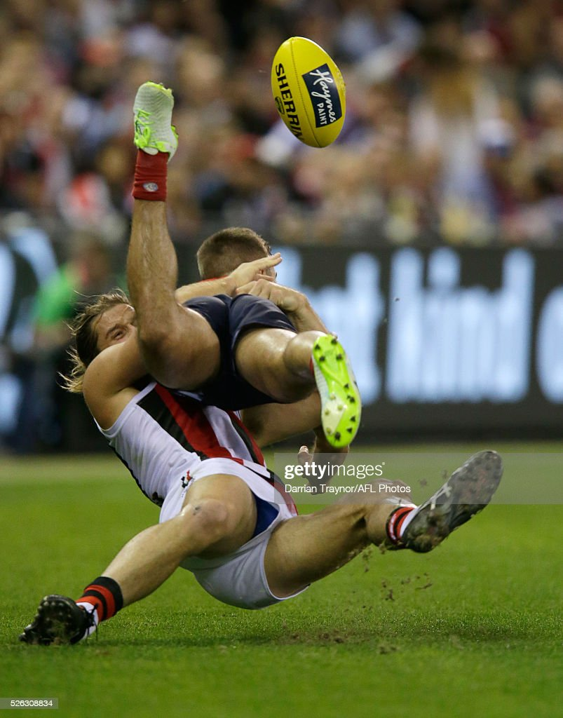 Josh Bruce of the Saints tackles Ben Kennedy of the Demons during the round six AFL match between the Melbourne Demons and the St Kilda Saints at Etihad Stadium on April 30, 2016 in Melbourne, Australia.