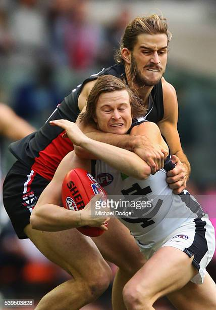 Josh Bruce of the Saints tackles high Liam Sumner of the Blues during the round 12 AFL match between the St Kilda Saints and the Carlton Blues at...