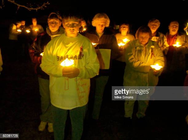Josh Bryant , brother of Jessica Marie Lunsford, takes part in a candlelight vigil March 5, 2005 in Roachester, Ohio. Lunsford's mom and much of her...