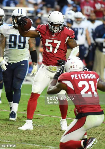 Josh Bynes of the Arizona Cardinals celebrates an interception by posing for a fake photo by teammate Patrick Peterson against the Tennessee Titans...
