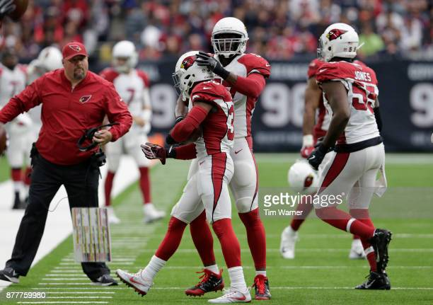 Josh Bynes of the Arizona Cardinals congratulates Budda Baker after an interception in the first half against the Houston Texans at NRG Stadium on...
