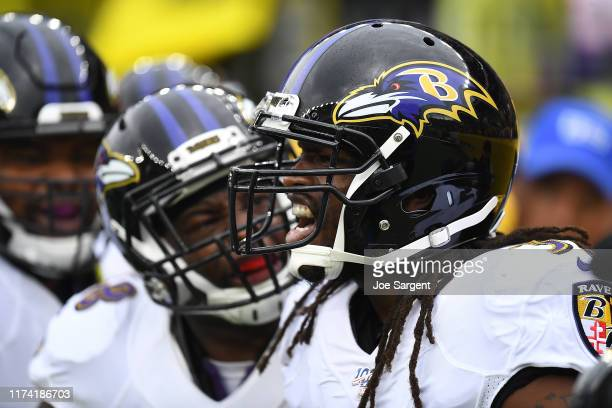 Josh Bynes of the Baltimore Ravens celebrates after intercepting a pass during the first quarter against the Pittsburgh Steelers at Heinz Field on...
