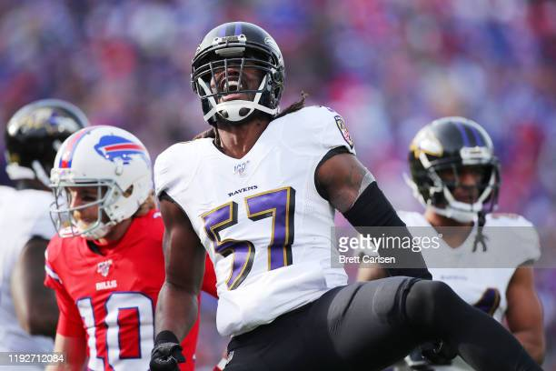 Josh Bynes of the Baltimore Ravens celebrates after sacking Josh Allen of the Buffalo Bills during the first half in the game at New Era Field on...