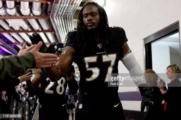 Josh Bynes of the Baltimore Ravens greets fans as he prepares to take the field against the San Francisco 49ers at M&T Bank Stadium on December 01,...