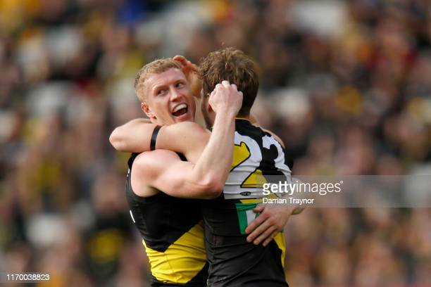 Josh Caddy and Kane Lambert of the Tigers celebrate a goal during the round 23 AFL match between the Richmond Tigers and the Brisbane Lions at...