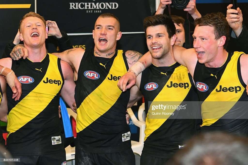 Josh Caddy, Dustin Martin, Trent Cotchin and Dylan Grimes of the Tigers celebrate in the rooms after winning the AFL Second Qualifying Final Match between the Geelong Cats and the Richmond Tigers at Melbourne Cricket Ground on September 8, 2017 in Melbourne, Australia.