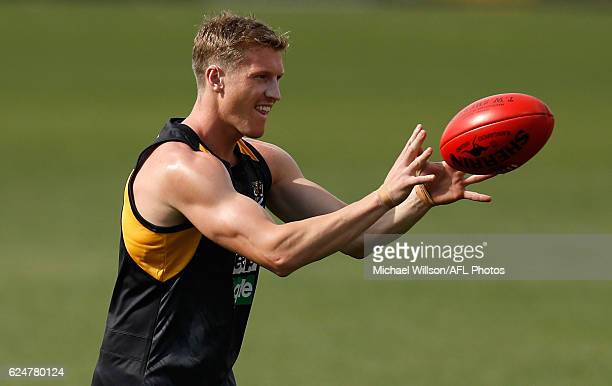 Josh Caddy marks the ball during a Richmond Tigers AFL preseason training session at the ME Bank Centre on November 21 2016 in Melbourne Australia