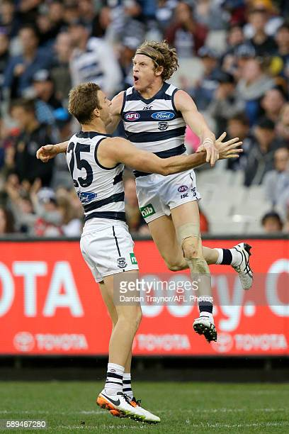 Josh Caddy of the Cats celebrates a goal during the round 21 AFL match between the Richmond Tigers and the Geelong Cats at Melbourne Cricket Ground...