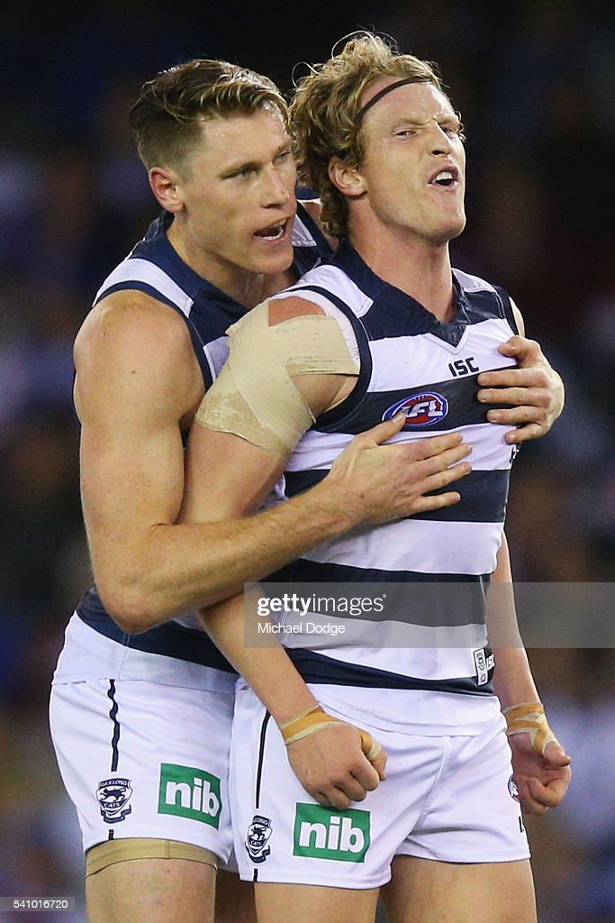 Josh Caddy of the Cats (R) celebrates a goal with Mark Blicavs during the round 13 AFL match between the Western Bulldogs and the Geelong Cats at Etihad Stadium on June 18, 2016 in Melbourne, Australia.