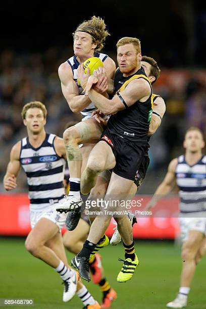 Josh Caddy of the Cats marks the ball during the round 21 AFL match between the Richmond Tigers and the Geelong Cats at Melbourne Cricket Ground on...