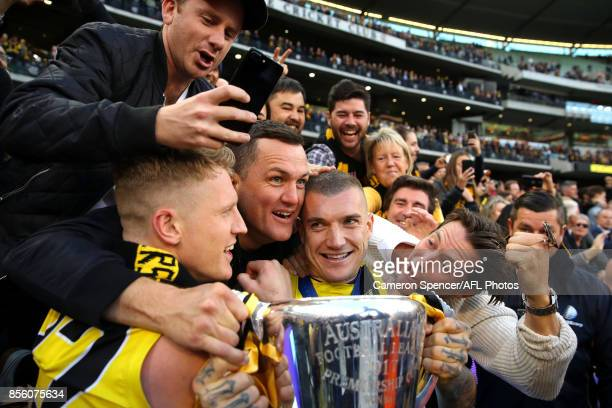 Josh Caddy of the Tigers and Dustin Martin of the Tigers celebrate with fans after winning the 2017 AFL Grand Final match between the Adelaide Crows...