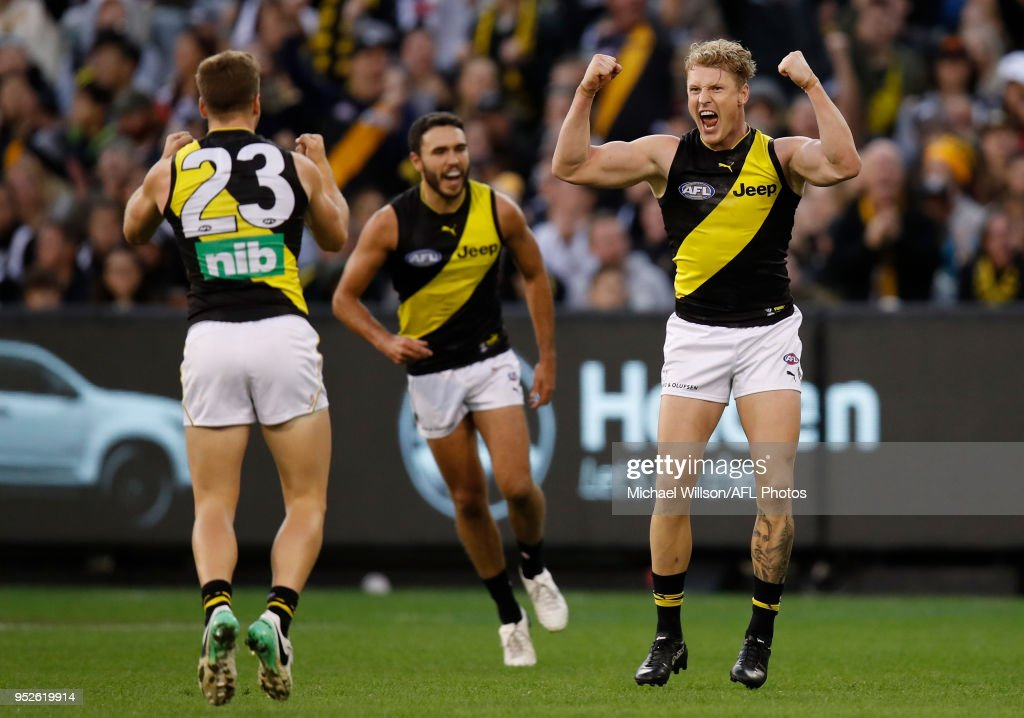 Josh Caddy of the Tigers celebrates a goal during the 2018 AFL round six match between the Collingwood Magpies and the Richmond Tigers at the Melbourne Cricket Ground on April 29, 2018 in Melbourne, Australia.
