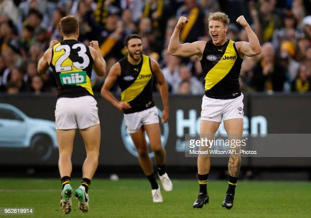 Josh Caddy of the Tigers celebrates a goal during the 2018 AFL round six match between the Collingwood Magpies and the Richmond Tigers at the...
