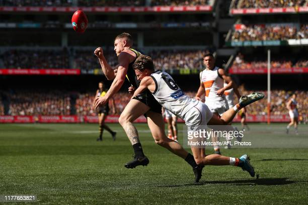 Josh Caddy of the Tigers is tackled by Lachie Whitfield of the Giants during the 2019 AFL Grand Final match between the Richmond Tigers and the...