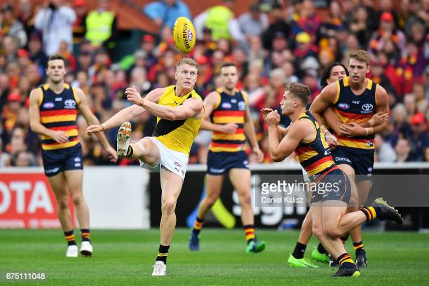 Josh Caddy of the Tigers kicks the ball during the round six AFL match between the Adelaide Crows and the Richmond Tigers at Adelaide Oval on April...