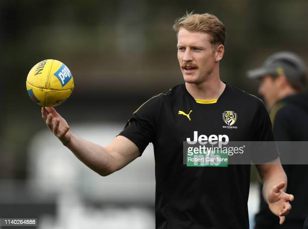 Josh Caddy of the Tigers looks on during a Richmond Tigers AFL training session at Punt Road Oval on April 04 2019 in Melbourne Australia