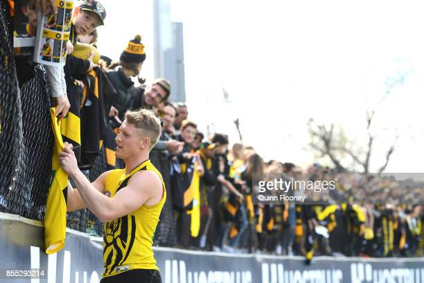 Josh Caddy of the Tigers signs autographs during a Richmond Tigers AFL training session at Punt Road Oval on September 29 2017 in Melbourne Australia
