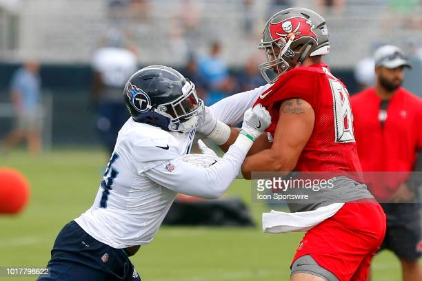 Josh Carraway of the Titans goes thru a drill against Antony Auclair of the Bucs during the joint training camp work out between the Tampa Bay...