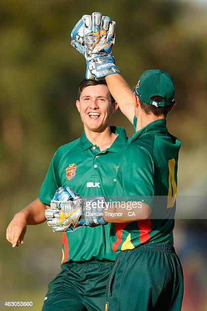 Josh Chapman celebrates with his brother Zac Chapman after taking a 'hat trick' against Queensland during the 20415 Imparja Cup on February 9 2015 in...