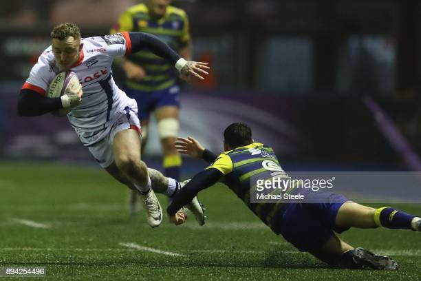 Josh Charnley of Sale evades the challenge of Tomos Williams of Cardiff during the European Rugby Challenge Cup Pool Two match between Cardiff Blues...
