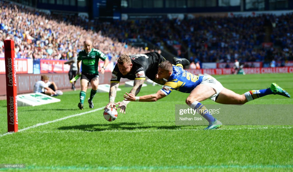 Josh Charnley of Warrington scores a try during the Ladbrokes Challenge Cup Semi Final match between Warrington Wolves and Leeds Rhinos at Macron Stadium on August 5, 2018 in Bolton, England.