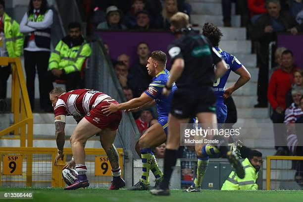 Josh Charnley of Wigan scores his sides second try during the First Utility Super League Final between Warrington Wolves and Wigan Warriors at Old...