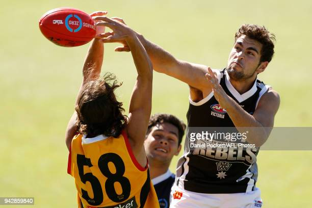 Josh Chatfield of the Rebels and William Hamill of the Stingrays contest the ball during the round three TAC Cup match between Dandenong Stingrays...