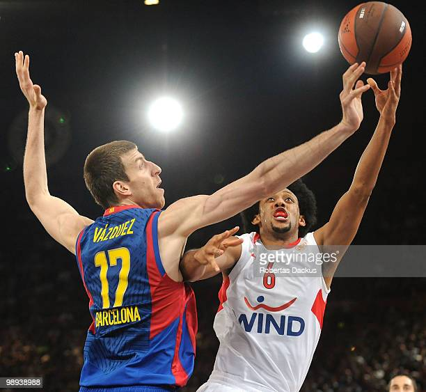 Josh Childress #6 of Olympiacos Piraeus competes with Fran Vazquez #17 of Regal FC Barcelona in action during the Euroleague Basketball Final Four...