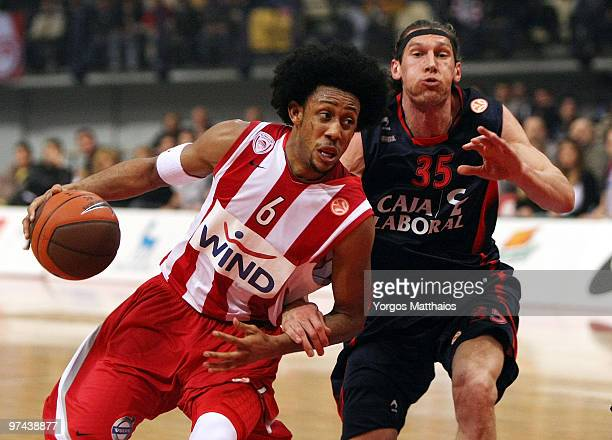 Josh Childress, #6 of Olympiacos Piraeus competes with Walter Herrmann, #35 of Caja Laboral during the Euroleague Basketball 2009-2010 Last 16 Game 5...