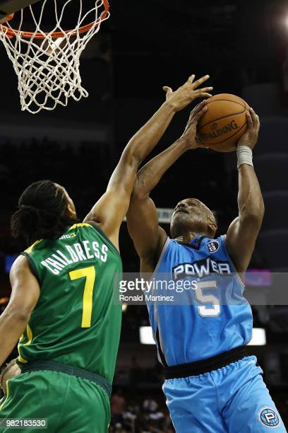 Josh Childress of Ball Hogs attempts to block the shot of Cuttino Mobley of Power during week one of the BIG3 three on three basketball league at...