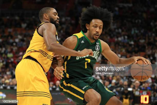Josh Childress of Ball Hogs tries to get past Alan Anderson of Killer 3's during a game during Big 3Week Five at American Airlines Arena on July 20...